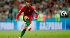 Portugal's Cristiano Ronaldo scores their third goal from a free kick to complete his hat-trick. Photo: Reuters