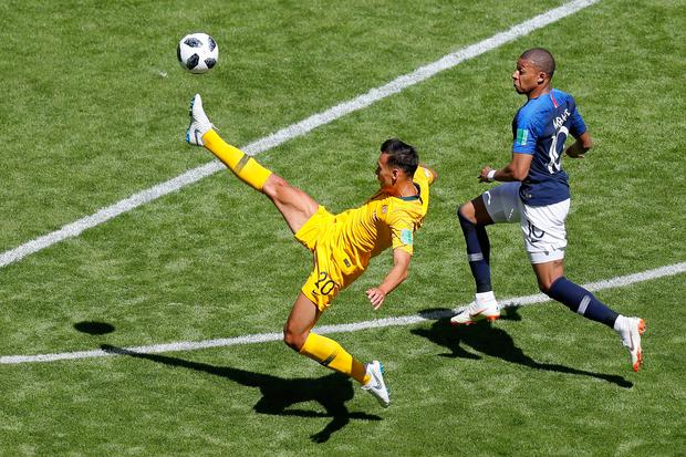 Trent Sainsbury of Australia controls the ball under pressure from Kylian Mbappe of France. Photo: Getty Images