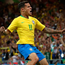 Flying high: Philippe Coutinho celebrates his goal against Switzerland