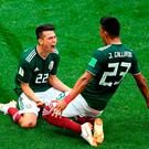 Hirving Lozano of Mexico celebrates with Jesus Gallardo by sliding on their knees after scoring his team's goal. Photo: Getty Images