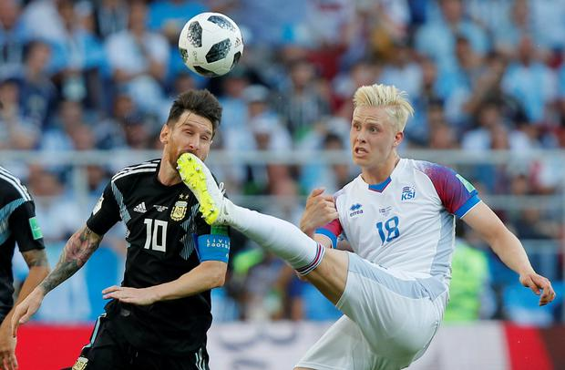 Argentina's Lionel Messi in action with Iceland's Hordur Bjorgvin Magnusson. Photo: Reuters