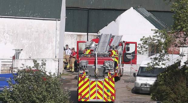Emergency services at the scene on the Ballyhanedin Road near Claudy Co Derry