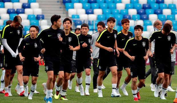 f9a606bed South Korean football squad swapped jerseys in training to confuse Swedish  spies. South Korea s squad during training REUTERS Carlos Barria