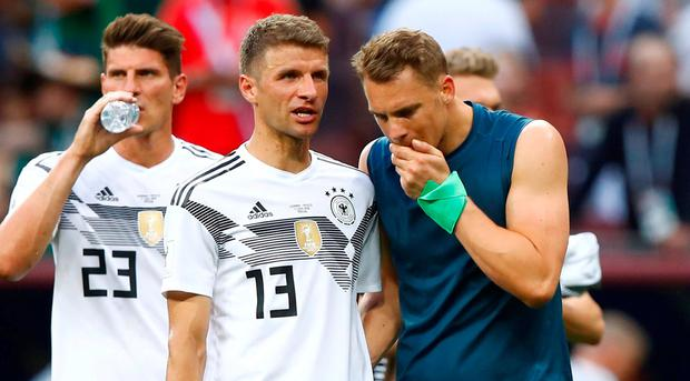 Germany's Thomas Muller and Manuel Neuer look dejected after the match. REUTERS/Axel Schmidt