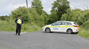 Gardai on duty following the discovery of the body of a 67-year-old male on the side of the road near Ballybane, Liscarroll, Co. Cork in a suspected hit and run incident. Pic by Provision