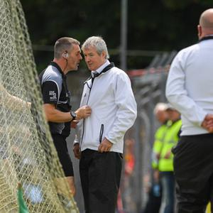 Referee James Owens consults with his umpires before they indicated a wide during the Munster GAA Hurling Senior Championship Round 5 match between Clare and Limerick at Cusack Park in Ennis, Clare. Photo by Ray McManus/Sportsfile