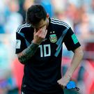 Argentina's Lionel Messi covers his face during the group D match between Argentina and Iceland