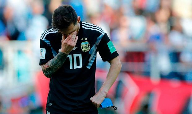 e57f92f6e Argentina s Lionel Messi covers his face during the group D match against  Iceland