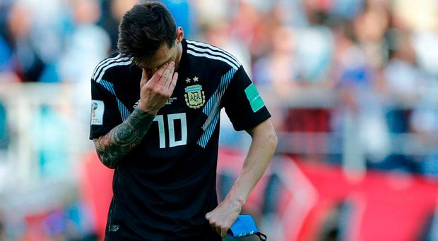 Argentina's Lionel Messi covers his face during the group D match against Iceland