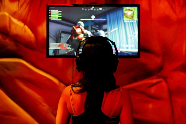 An attendee plays a video game at E3, the world's largest video game industry convention in Los Angeles, California, U.S. June 12, 2018. REUTERS/Mike Blake/File Photo
