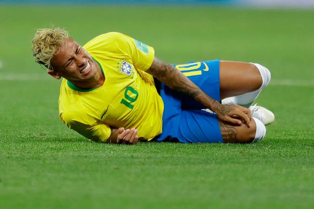 Brazil's Neymar grimaces during the group E match against Switzerland