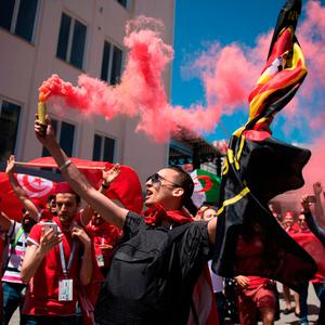 Tunisian football fans cheer upon their arrival at the Volgograd railway station in Volgograd on June 18, 2018, during Russia 2018 World Cup football tournament. / AFP PHOTO / NICOLAS ASFOURINICOLAS ASFOURI/AFP/Getty Images