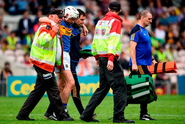Brendan Maher of Tipperary is substituted due to an injury during the Munster GAA Hurling Senior Championship Round 4 match between Tipperary and Clare at Semple Stadium in Thurles, Tipperary. Photo by David Fitzgerald/Sportsfile