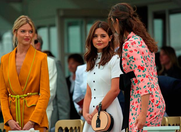 (left to right) American model Martha Hunt and actress Jenna Coleman seen before the start of the Cartier Trophy at the Guards Polo Club, Windsor Great Park, Surrey