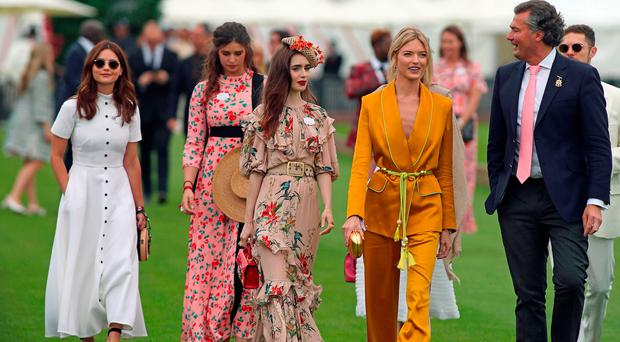 (left) Jenna Coleman, Lily Collins, centre, Lily Collins, and Martha Hunt, second from right, seen before the start of the Cartier Trophy at the Guards Polo Club, Windsor Great Park, Surrey