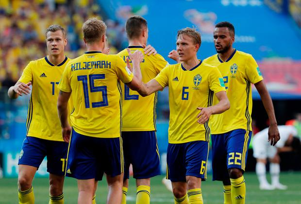 Sweden's Ludwig Augustinsson shakes hands with Oscar Hiljemark