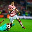 LENS, FRANCE - JUNE 25: Nikola Kalinic of Croatia is tackled by Jose Fonte of Portugal during the UEFA EURO 2016 round of 16 match between Croatia and Portugal at Stade Bollaert-Delelis on June 25, 2016 in Lens, France. (Photo by Clive Mason/Getty Images)