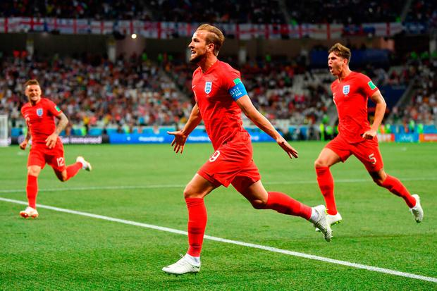 VOLGOGRAD, RUSSIA - JUNE 18: Harry Kane of England celebrates after scoring his team's first goal during the 2018 FIFA World Cup Russia group G match between Tunisia and England at Volgograd Arena on June 18, 2018 in Volgograd, Russia. (Photo by Dan Mullan/Getty Images)