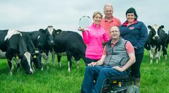 Kevin Downing, overall winner of the Dairygold Milk Quality Awards, with his wife Bernie, farm manager Tom Carr and Dairygold advisor Maeve O'Connor on his dairy farm in Whitechurch, Co Cork.