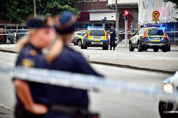 Police stand next to a cordon after a shooting on a street in central Malmo, Sweden June 18, 2018. TT News Agency/Johan Nilsson/via REUTERS