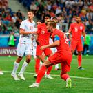 VOLGOGRAD, RUSSIA - JUNE 18: Harry Kane of England scores his team's second goal uring the 2018 FIFA World Cup Russia group G match between Tunisia and England at Volgograd Arena on June 18, 2018 in Volgograd, Russia. (Photo by Matthias Hangst/Getty Images)