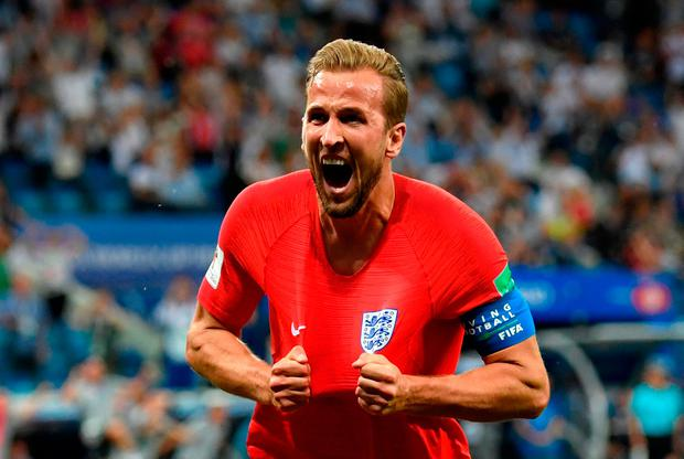 VOLGOGRAD, RUSSIA - JUNE 18: Harry Kane of England celebrates after scoring his team's second goal during the 2018 FIFA World Cup Russia group G match between Tunisia and England at Volgograd Arena on June 18, 2018 in Volgograd, Russia. (Photo by Matthias Hangst/Getty Images)