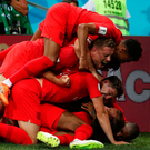Harry Kane is mobbed by his England team-mates – (from top) Jesse Lingard, Jordan Henderson and John Stones – after heading home a late winner in his team's World Cup Group G opener against Tunisia last night Photo: Reuters
