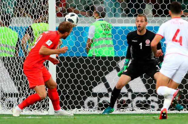 Harry Kane heads a late winner for England as they finally broke down Tunisia's resistance. Photo: PA