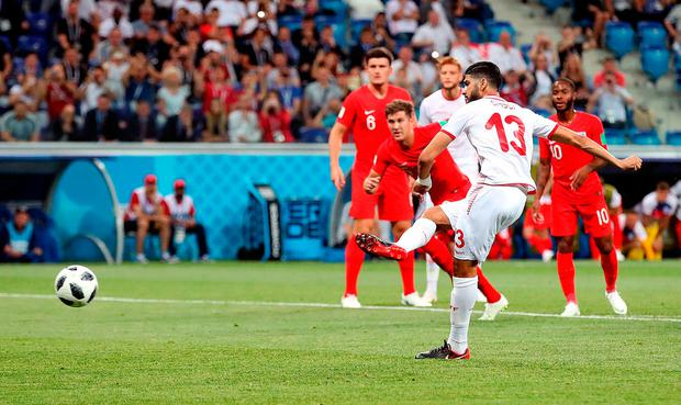 Ferjani Sassi equalises for Tunisia from the penalty spot. Photo: PA