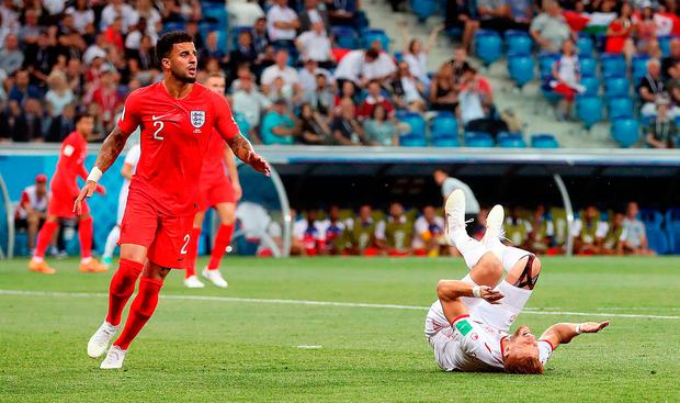 Kyle Walker (left) concedes a penalty after colliding with Tunisia's Fakhreddine Ben Youssef. Photo: PA