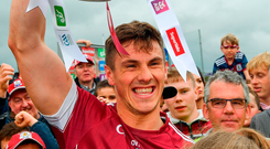 Galway's Shane Walsh celebrates with the Nestor Cup after his team's victory over Roscommon Photo: Ramsey Cardy/Sportsfile