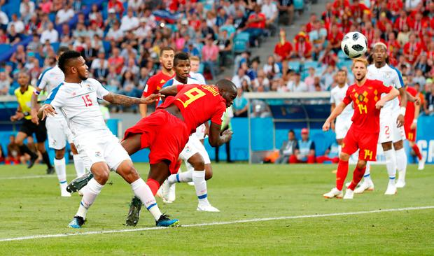 Romelu Lukaku heads in Belgium's second goal. Photo: REUTERS/Francois Lenoir