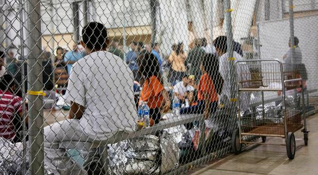 People in custody related to cases of illegal entry into the United States, held in one of the cages at a facility in McAllen, Texas. U.S. Photo: Customs and Border Protection's Rio Grande Valley Sector via AP