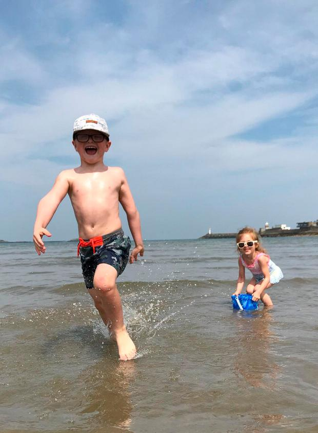 Thrill seekers Barney McAnally (6) and Isabella Falchetto (4) make a splash at Claremont Beach in Dublin's Howth last week. Picture: Gillian Walsh Photography