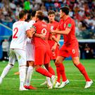 Yassine Meriah of Tunisia clashes with Harry Kane of England in the box