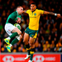 Keith Earls of Ireland catches a high ball ahead of Israel Folau of Australia
