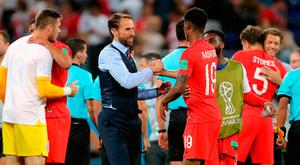 England manager Gareth Southgate (centre) and Marcus Rashford celebrate after the final whistle