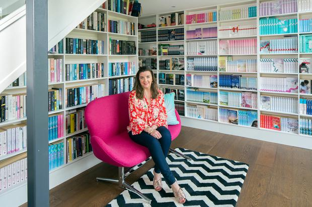 Melissa in her library with many editions of her own books, and also the thrillers she has written jointly with her husband, Kevin, under the pseudonym Casey Hill. Photo: Tony Gavin