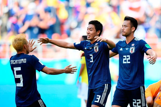 Yuya Osako snatches shock victory for Japan against 10-man Colombia
