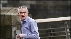 Serial Rapist Paul Moore runs across Eden Quay from O'Connell Bridge heading towards Marlborough Street.