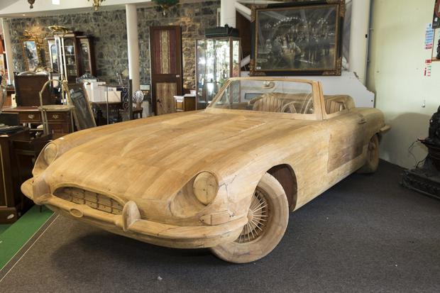 The almost life-sized wooden E-Type Jaguar, recently made famous by Prince Harry and Meghan Markle sold today for €4,000 in a massive two-day sale at Heritage Hotel, Killenard. Picture: Michael Donnelly.