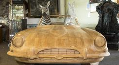 The almost life-sized wooden E-Type Jaguar, recently made famous by Prince Harry and Meghan Markle sold today for €4,000 in a massive two-day sale at Heritage Hotel, Killenard Picture: Michael Donnelly.