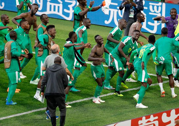 Senegal players celebrate after the group H match between Poland and Senegal at the 2018 soccer World Cup in the Spartak Stadium in Moscow, Russia, Tuesday, June 19, 2018. (AP Photo/Themba Hadebe)