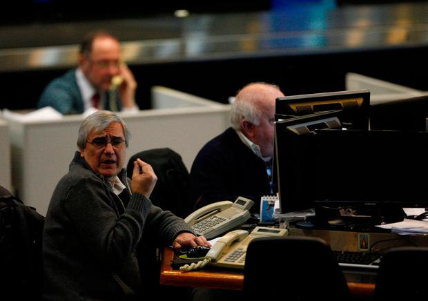 Traders work on the floor of Buenos Aires Stock Exchange, Argentina. Photo: Reuters