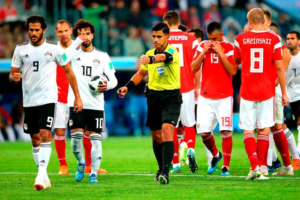 Referee Enrique Caceres awards Egypt a penalty after consulting VAR in their game against Russia last night. Photo: Alex Livesey/Getty Images