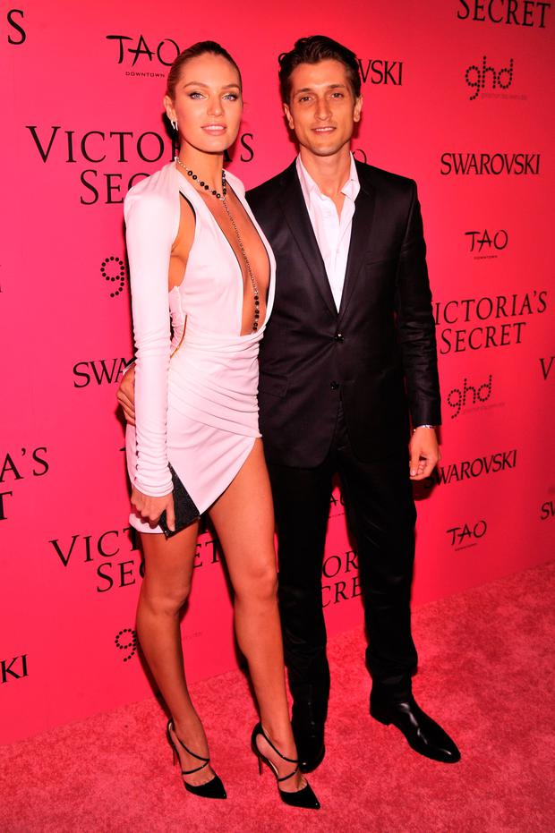 Model Candice Swanepoel and Hermann Nicoli attend the 2013 Victoria's Secret Fashion Show at TAO Downtown on November 13, 2013 in New York City. (Photo by Stephen Lovekin/Getty Images)