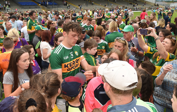 David Clifford of Kerry signs autographs for supporters after the Munster GAA Football Senior Championship semi-final match between Kerry and Clare