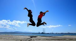 Faeba Francis and Ashly Simon from Newry enjoy the summer sunshine on the Bull Wall in Dublin. Picture; Gerry Mooney