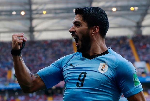Uruguay's Luis Suarez celebrates scoring his side's first goal during the group A match against Saudi Arabia.