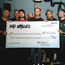 Bad Wolves with their cheque for $250,000. L-R: Doc Coyle (Guitar), Don Burton, Taylor Burton, Kyle Konkiel (Bass), Don Burton Jr., Tommy Vext (Vocals), John Boecklin (Drums), Chris Cain (Guitar)